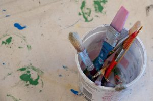 cup of paint brushes