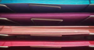 Stacks of paper on a shelf
